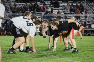 The juniors and seniors face off during the Homecoming Powderpuff football game on September 29 at McCracken Field.