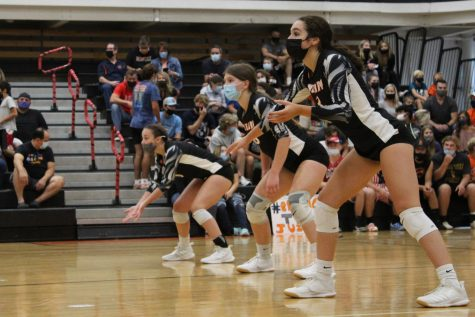 The JV volleyball team competes against Dundee-Grown during a match on September 9 in the Freshman Campus main gym.