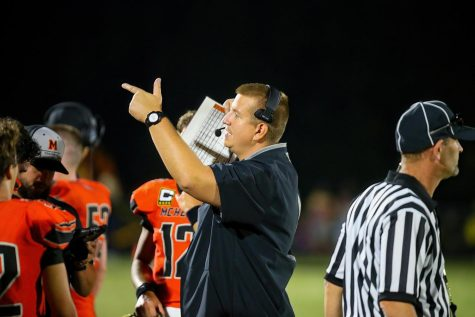 Niemic directs his varsity football team during the Homecoming football game.
